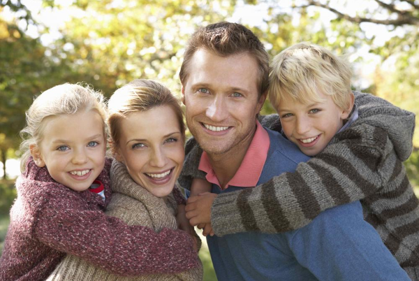 Smiling Couple with Children
